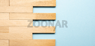 Solid wood parquet as wood texture on blue background with space for text