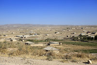 The road in the desert area of Uzbekistan. Buildings