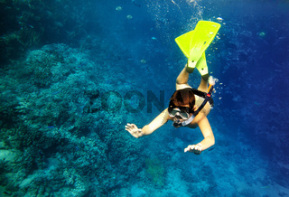 boy floats under water