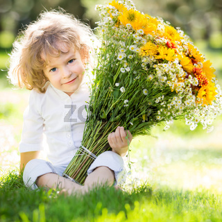 Child with bouquet flowers