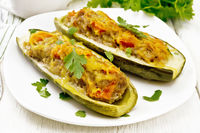 Cucumber stuffed with meat and vegetables on light board