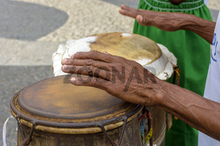 Afro-brazilian cultural manifestation with man hands playing atabaque