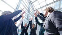 Successful business people with high-five
