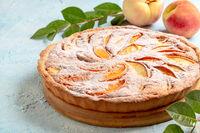 Peach pie with almond cream.