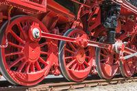 Wheels of a historic steam locomotive on tracks