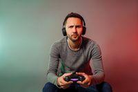 Man holding joystick and play virtual game
