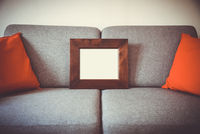 Blank picture frame on a sofa