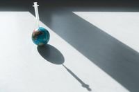 Pessimistic symbol for global vaccination against covid-19 on the earth with syringe in planet