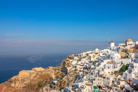 Windmills and White Houses on a Mountainside in Oia Town
