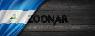 Nicaragua flag on black wood wall banner