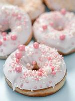 Romantic glazed donuts. white glaze, pink dressing