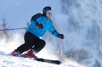 Caving skier