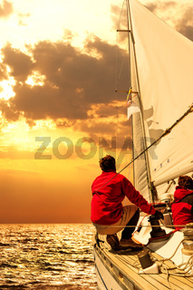 People on sailing boat in the sea
