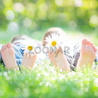 Active couple lying on grass