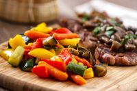 Grilled beefsteak with mushrooms and mixed vegetables.