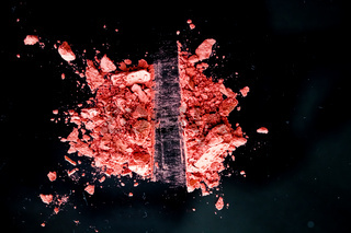 Crushed cosmetics, mineral organic eyeshadow, blush and cosmetic powder isolated on black background, makeup and beauty banner, flatlay design