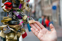 Love safety locks over a Amsterdam canal bridge. Love and travel concept.