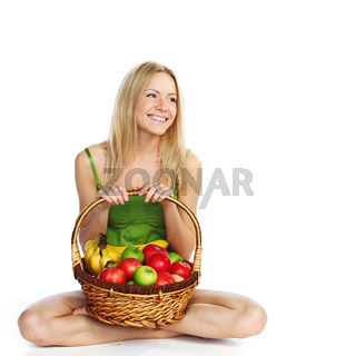 woman holds a basket of fruit