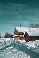 old farmhouse amongst white snow
