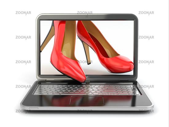 E-commerce. High heel shoes on laptop.