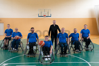photo of the basketball team of war invalids with professional sports equipment for people with disabilities on the basketball court