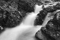 black and white image of beautiful waterfall