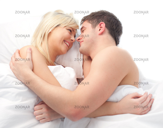 loving Couple relaxing on bed
