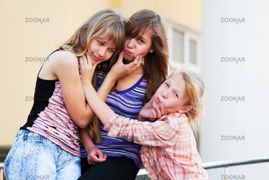 Schoolgirls having fun in a campus