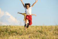 Two kids on meadow