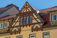 Gable of a half-timbered house with colorful decorations in Meiningen