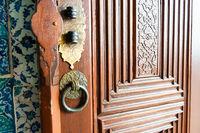 Old wooden door with doorknob