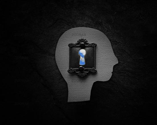 Textured head figure with vintage lock and blue sky keyhole