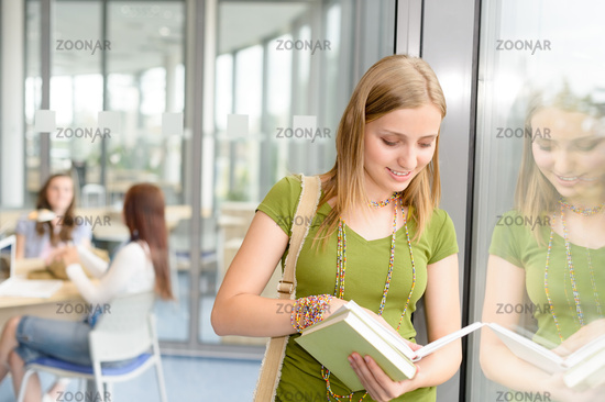 High school student read book by window