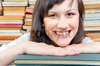 Cheerful young university student  and her books