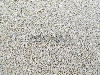 Full frame of clean white pebbles closeup
