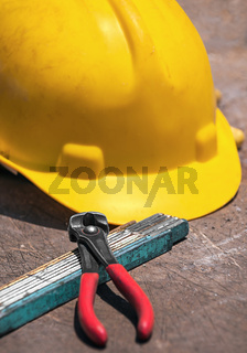 Construction tools on wooden table