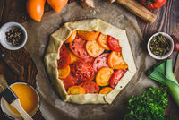 Uncooked tomato galette on baking paper