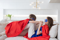 Mother and daughter play superhero