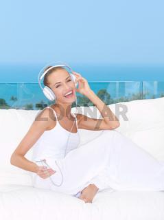 Vivacious woman listening to music