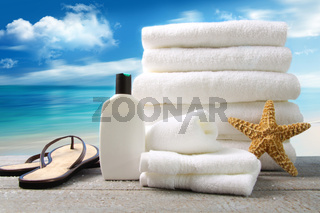 Lotion  towels and sandals with ocean scene