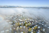 foggy spring morning over residential area of Fort Collins