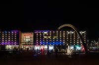 Exterior view of shopping centre Galeria Krakowska and modern Arch at night, Krakow