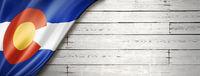 Colorado flag on white wood wall banner, USA
