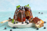 Marble bundt cake with chocolate icing and blueberries.