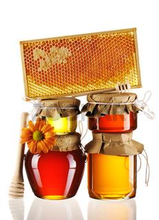 Jars of honey and dipper