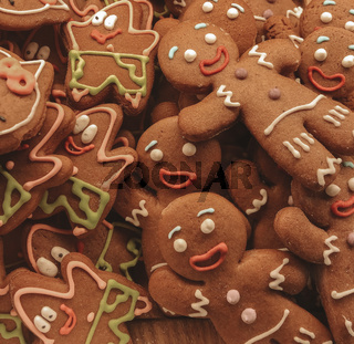 Homemade xmas gingerbread cookies in shapes of smiling men and starfish Patrick