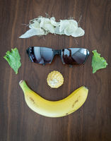 Face made of parts of healthy food
