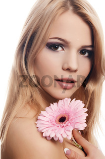 The beautiful woman with a Gerbera flower isolated on white