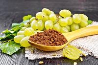 Flour grape seed in spoon on board