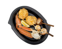 dish of seafood including crab leg, scallop, shrimpand crab cake
